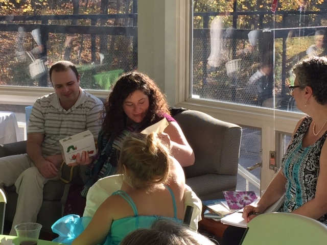 Opening gifts. Photo by Amy Burkhart.