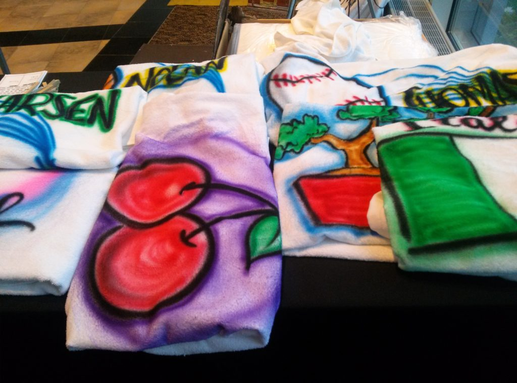 Airbrush beach towels were evening favors for the kids!