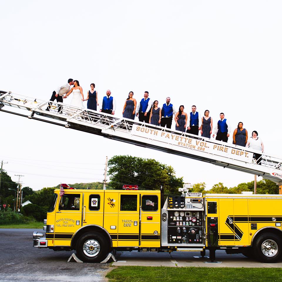 Tara on the Fire Truck with Bridal Party