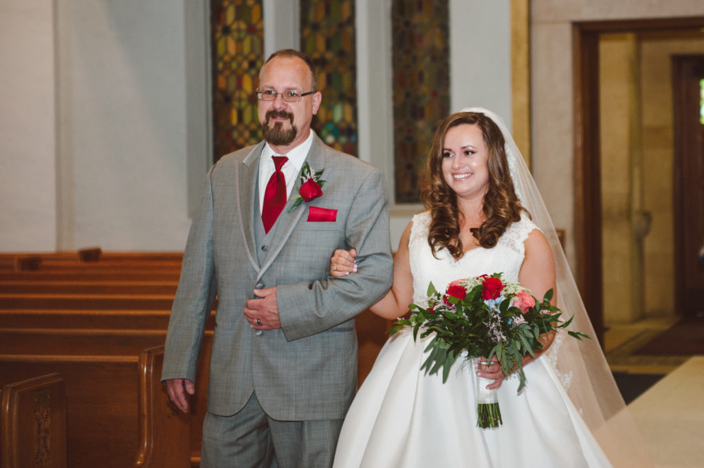 Nichole and Dad down the aisle